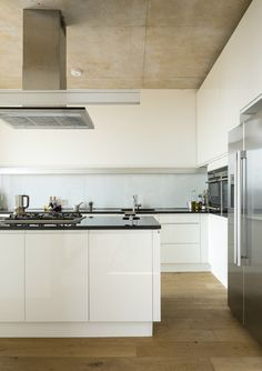 High gloss white kitchen with black worktops