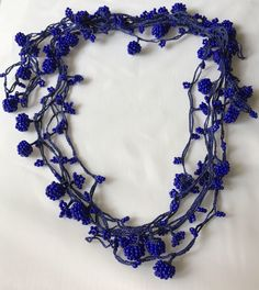 A personal favorite from my Etsy shop https://www.etsy.com/listing/536992905/157-inches-dark-bluenavy-beaded-necklace