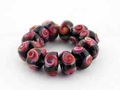 Sheribeads Glass Lampwork Beads.  Rose bouquet spacers, 2mm holes.  Available to purchase on Facebook in the group:  Lampwork Bead Market.  Search for Sheri Chase Jones within the group :)  https://www.facebook.com/groups/lampworkbeadmarket/search/?query=sheri%20chase%20jones