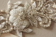 Nostalgic of precious jewelry, each MillieIcaro Sash is made from pearls, mounted swarovski crystals, and silk thread. Beautifully intricate, each sash emanates