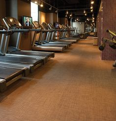 Containing odor and stain-inhibiting Microban material, Chilewich custom tile flooring in Basketweave Latte was a perfect choice for the Grand Hyatt Hotel Fitness Center.
