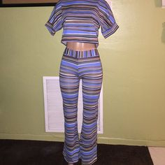 Striped Two Piece Set Striped two brown, blue, cream and black two piece. The crop top and wide leg pants make this set super cute. The has never been worn and was once in a boutique. If your a small or between a small and medium this set is for you! Great thick stretch material. Other