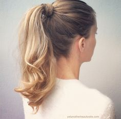 Add some extra height and cover your hair tie with a twist of hair with this modern high pony tail.