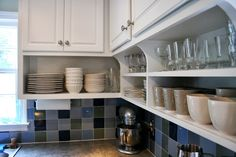 Cabinets with open shelves beneath