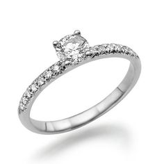 This classical solitaire ring is made of 14k white gold with round-cut central Diamond of 0.5 carats, color F and clarity SI1. 14 small white Diamonds beside the main stone add nice accents to the jewelry item. This high quality handmade diamond ring can become a great engagement ring to your lovely one. Can be made in any size by your request and will be sent in a beautiful present box.