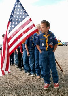Cub Scouts with flag ~ Picture idea for our den, take a picture of each boy in front of the flag.