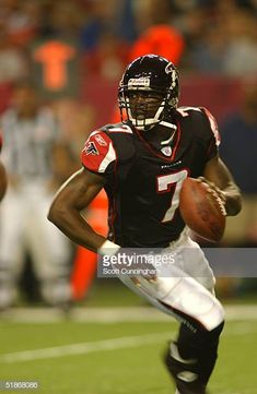 Atlanta Falcons quarterback MIchael Vick rolls out during a 27 to 21 loss to the Green Bay Packers in a preseason game on Atlanta Falcons Team, Michael Vick, Football Conference, Sports Stars, Green Bay Packers, Football Players, Wisconsin, Nba, Rolls