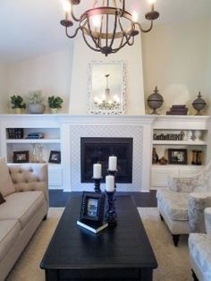 lantern shaped tile, custom fireplace, chandeliers, living room
