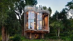 Four cylindrical towers are elevated on stilts to create this retreat in Cape Town, which was designed by Malan Vorster to offers views among the trees