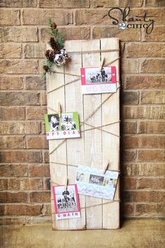 This card holder, assembled from furring strips, is a DIY masterpiece decorated with a dark stain, twine, jingle bells, pinecones, and stems.