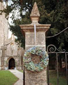 A large wreath of hydrangeas can represent the entrance to your ceremony, like it did at this church wedding in England.