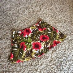 Swimsuit Coverup Skirt Tropical Print This skirt is brightly colored and would go well over a solid swimsuit. It has green-earthy tones and pops of coral-red. It is stretchy fabric for a comfortable fit. Swim Coverups