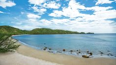 The stunning beach at Dreams Las Mareas surrounded by the Costa Rican mountains!