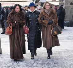 Two ladies in mink coats. Love especielly this full lenght coat,amazing sweep!  Many minks used for it.