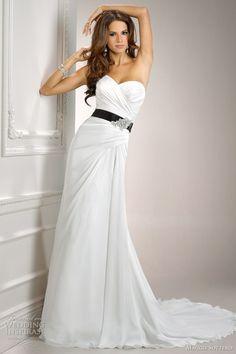 I like the idea of the black sash to match! classic white wedding dress with black  www.brayola.com