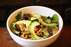 Signutre Salad with our home made smoked paprika dressing, avocado, candied walnuts, carrots, goji berries, & tofu ! #signituresalad #avocado #mesculan #candiedwalnuts #organic #veggie #green #homemade #eastvillage #vegan #nyc #eco