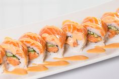 Orange Blossom($11.50) - Spicy salmon, cucumber topped w/salmon, spicy mayo sauce