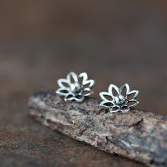 Dainty lotus flower stud earrings made of solid sterling silver - delicate and feminine. - Flowers measure approx 10 mm across (0.39 inches) - Earrings will be shipped with sterling silver backs I sli