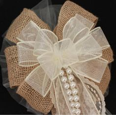 Rustic ivory and burlap wedding bow for the perfect combination for a rustic wedding. Great selection of burlap wedding bow in a variety of colors.