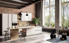 pavimento in parquet scuro e cucina con isola con mobili e sgabelli ...