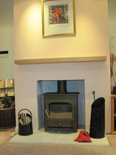 Clearview Vision 500 in Goldenfire Brown - on a Bathstone hearth with floating oak mantle shelf. Happy Birthday Senel - looks lovely. Wood Burner Fireplace, Oak Mantle, Mantle Shelf, Fireplace Mantels, Fireplace Ideas, Living Room Update, My Living Room, Chimney Breast, Living Room Shelves