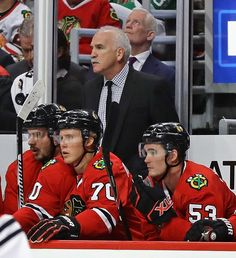 Head coach Joel Quenneville of the Chicago Blackhawks watches as his team takes on the St. Louis Blues during a preseason game at the United Center on October 1, 2016 in Chicago, Illinois. The Blackhawks defeated the Blues 4-0.