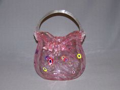 Hand-Blown-Murano-glass-pink-purse-vase-Millefiori-applied-bows-and-buttons