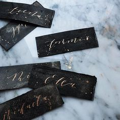 gold ink on black hand-dyed paper calligraphy place cards Laser Cut Wedding Invitations, Diy Wedding Favors, Rustic Invitations, Wedding Stationary, Wedding Decor, Dinner Invitations, Wedding Table, Wedding Colors, Wedding Venues