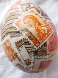 wooden eggs covered in vintage stamps