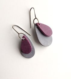 Teardrop earrings in wine and grey. Components are heavily textured polymer clay. They are very lightweight making these earrings so easy and