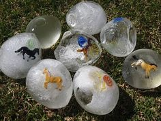 ice eggs - Freeze balloons filled with water and small toys. Cut balloon off and play with eggs outside. Provide spoons for cracking ice and digging treasures out. SUMMER
