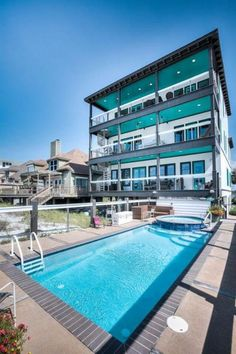Gorgeous pool and hot tub combination to compliment your three story, beachfront home.
