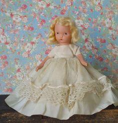 Vintage Bisque Nancy Ann Storybook Doll in by TinselandTrinkets in Etsy.