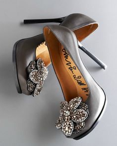 I love the detail on the front of the shoes, but I'd prefer them as flats, otherwise I'll kill myself in them.