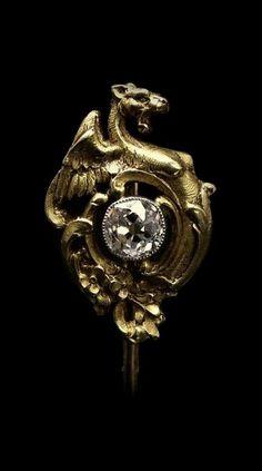 Diamond, silver and gold dragon stickpin, circa 1900.