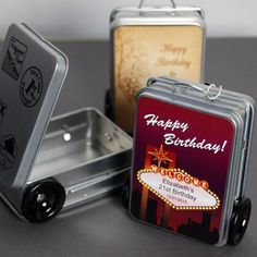 "With a hanging tag that reads ""Thanks for making the trip!"" our personalized mini suitcase favor tins are perfect travel themed party favors or destination wedding favors. Each tin is complete with rolling wheels, pull handle and retro travel stickers."