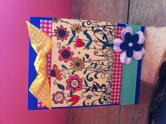 Utilizing various colors in the main image bring your card to life, as seen here. The yellow ribbon up top and flower down below make this card stand out.