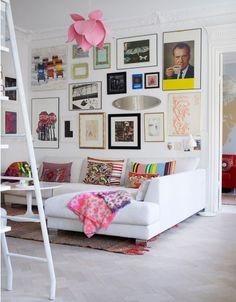 Eclectic mixes of patterns and art with a white base. Map wallpaper in the other room adds to a lovely mix too!