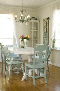 Idea for dining room.  After a closer look her different style chairs are painted in an ombre kind of fashion without being displayed that way.