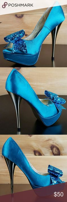 Luichiny Kissy Kiss Teal Satin Glitter Bow Size 9 Adorable Kissy Kiss pump features a teal satin upper glitter bow with a metallic 5 inch heel and 1 inch platform.   Peep Toe design   Luichiny's Signature Heart Stamp Sole Email us with any questions  More sizes available Twf.shoes Luichiny Shoes Heels