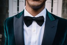 A groom is wearing a racing green velvet dinner jacket and a black bow tie for his evening wedding reception at Drumtochty Castle. Velvet Jacket Men, Green Velvet Jacket, Velvet Dinner Jacket, Wedding Venues Scotland, Unusual Wedding Venues, Groom Wear, Groom Attire, Evening Wedding Receptions, Scottish Clothing