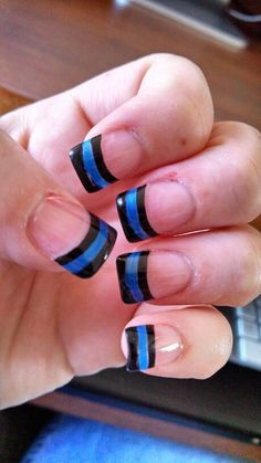 Police nails.... The thin blue line. I want to make fun but this is serious....so conflicted.