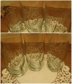 painstaking but cheap and easy christmas gift DIY!  i made this set of etched glasses with all our names and a symbol that represented each of us for my MIL using Amour Etch cream ($35, but i still have an entire bloody bottle), masking tape, a sharpie and an exacto knife. unbelievably cheap, and such a great way to make something sentimental on the cheap.
