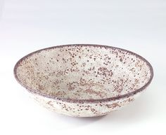 NATZLER Fine bowl covered in an ivory and brown volcanic glaze