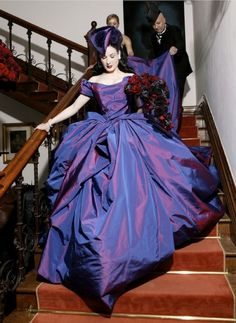 A non traditional Bride: On December 3, 2005, shock rocker Marilyn Manson and Dita Von Teese were married in a private non-denominational ceremony at artist Gottfried Helnwien's castle, Ireland. Von Teese wore a royal purple silk taffeta gown, made by Vivienne Westwood Couture, a tri-corned hat designed by Stephen Jones and matching Mr Pearl corset. Christian Louboutin designed her shoes...