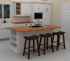 This white IKEA kitchen island includes a cooktop to provide an efficient work triangle.