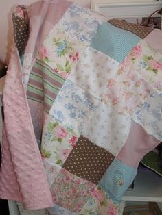 Cute idea to make a memory quilt from your kids' baby clothes