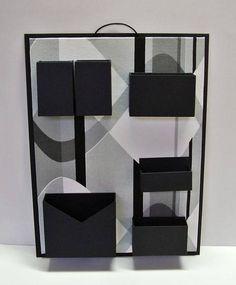 Organizador de materiais de escritório de parede. Cartonagem com revestimento em tecido estampado e papel. Ideal para não ocupar espaço em sua mesa de escritório. R$ 75,00