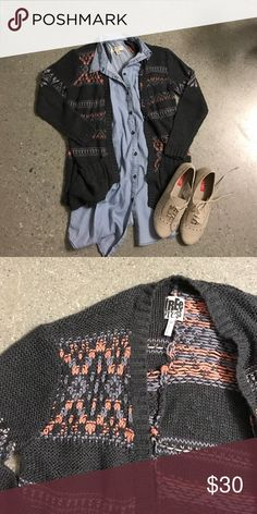 Free press cardigan NWOT I love this sweater, but I've never actually worn it! I imagined pairing it with a chambray shirt and oxfords for a more preppy look. The cardigan is really light and airy. The texture is a little holey, so air does get through the sweater. It is a great spring sweater! free press Sweaters Cardigans