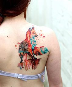Pretty geometric fox with trees in the background, done on girls shoulder blade by Martynas Šnioka, a tattoo artist based in Vilnius, Lithuania.